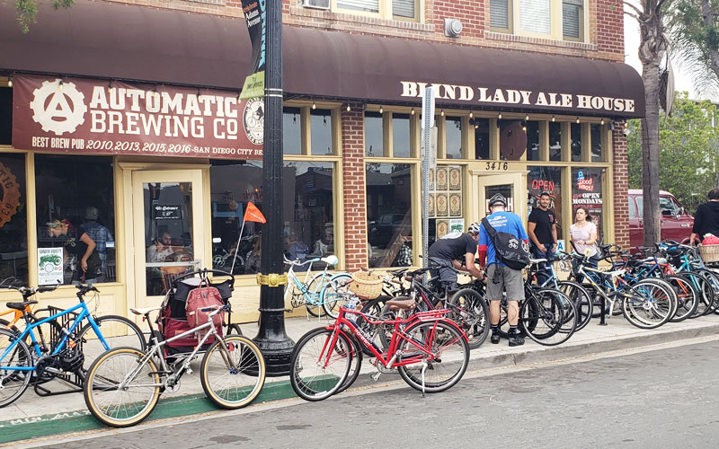 Bikes parked in front of businesses