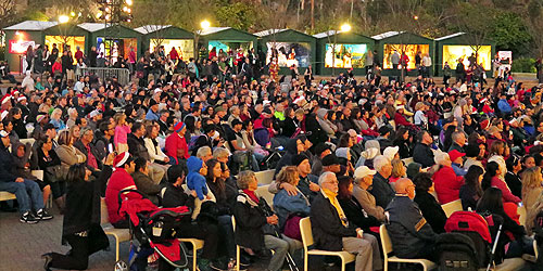 December Nights attendees sitting down and watching a show at the Organ Pavilion