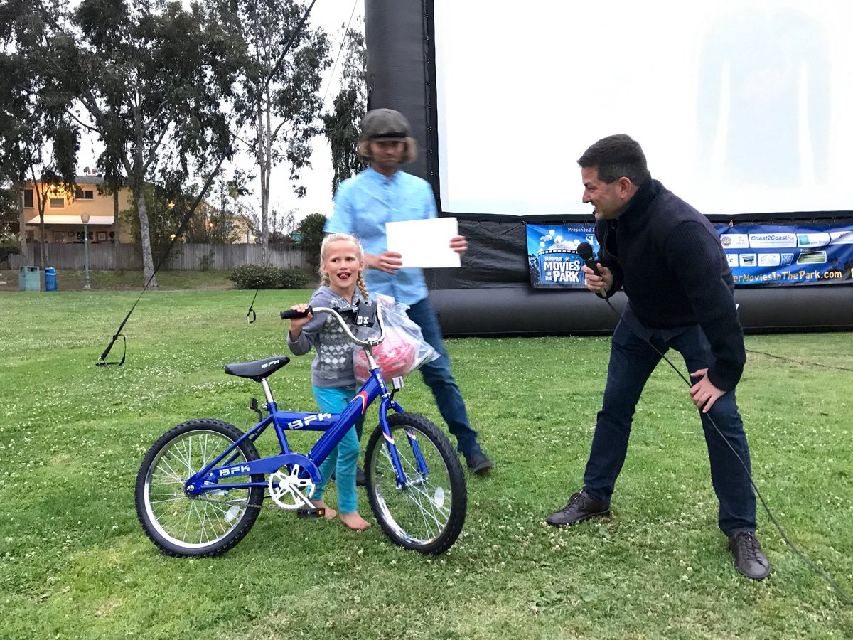 Raffling off bikes after kicking off the UHCA's movies in the park