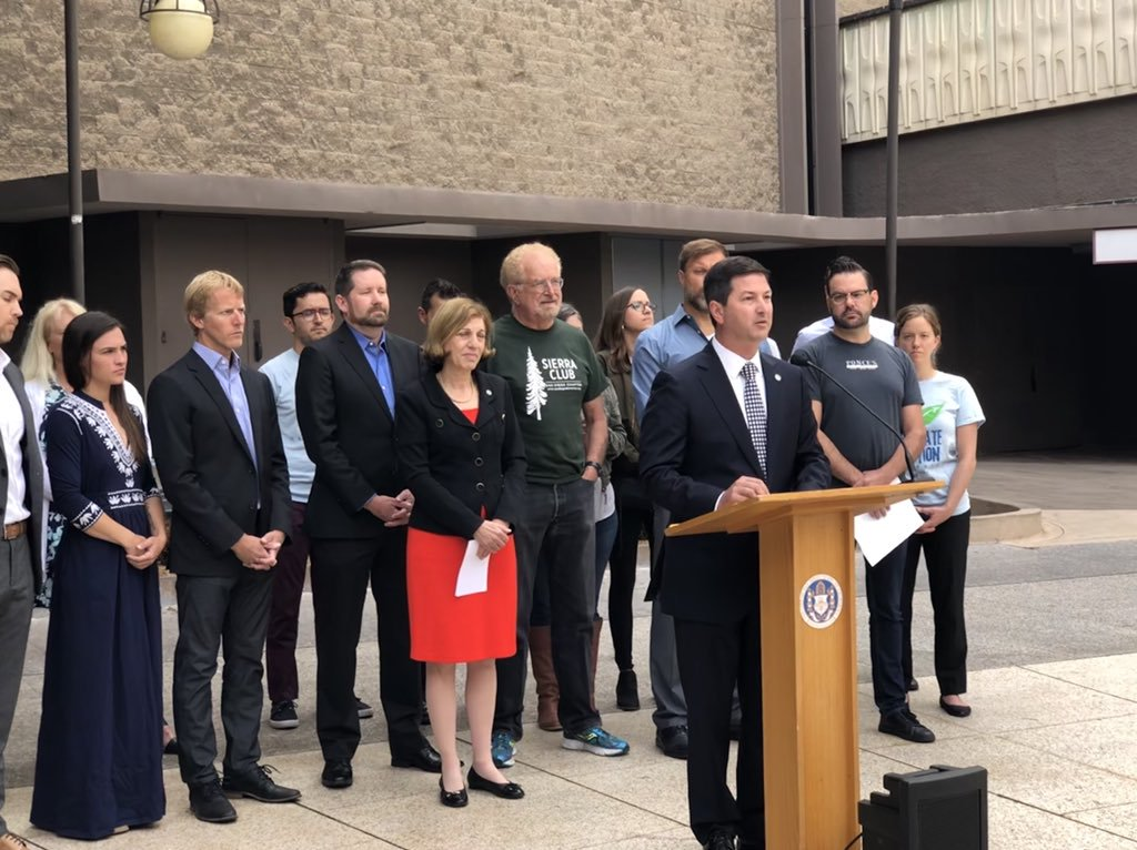 Councilmember Ward standing with residents advocating for a ban on harmful styrofoam packaging