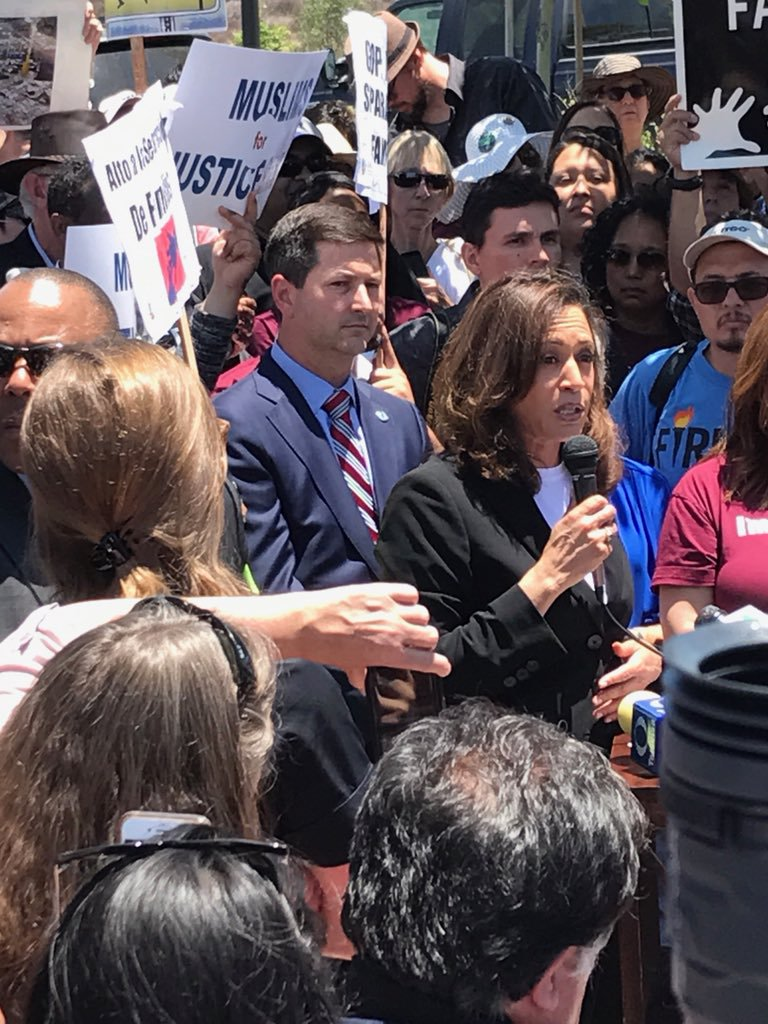 Councilmember Ward standing with community members, residents, Senator Kamala Harris to demand justice for families seeking asylum