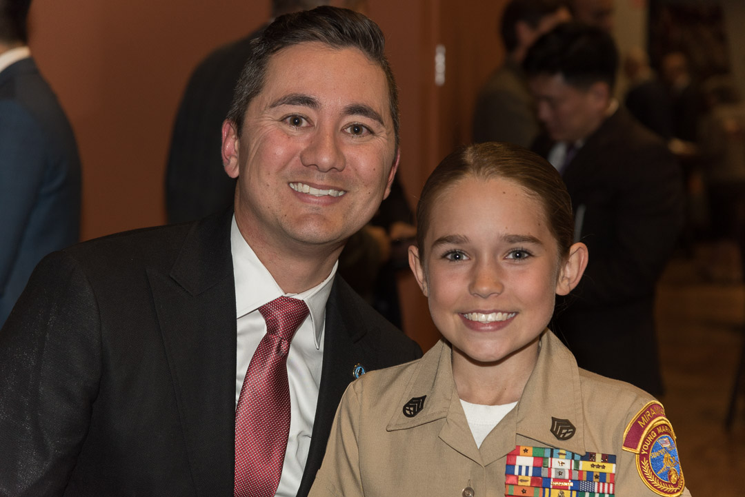 Photo of Councilmember Cate and child in uniform