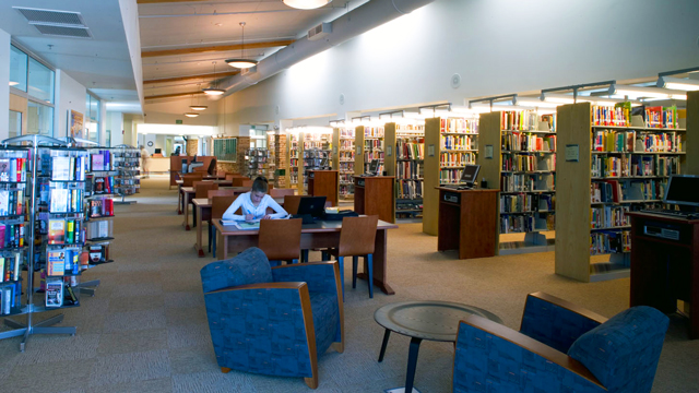 Reading area and book stacks inside the College-Rolando Library