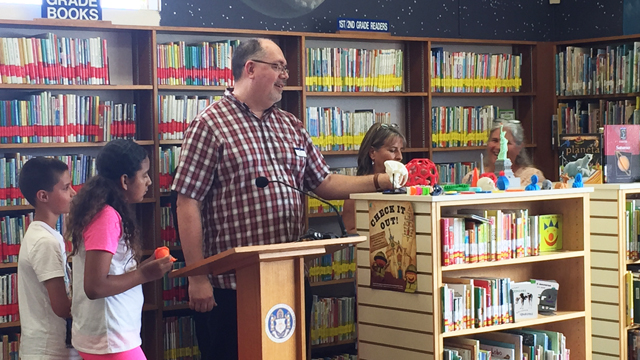 Bill Mallory, Branch Manager, announces new 3D printing program at the Clairemont Library