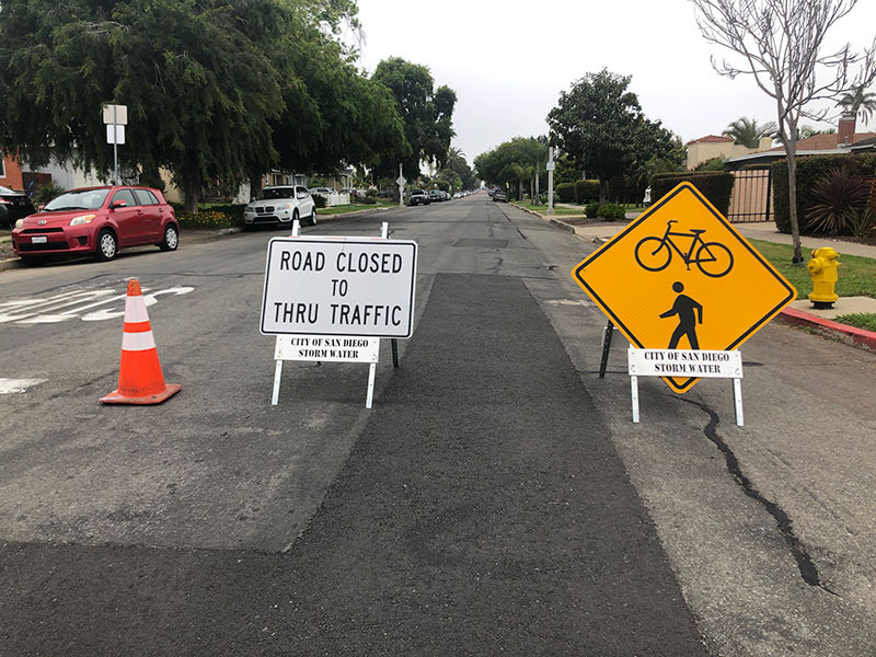 Construction signs on a newly paved road