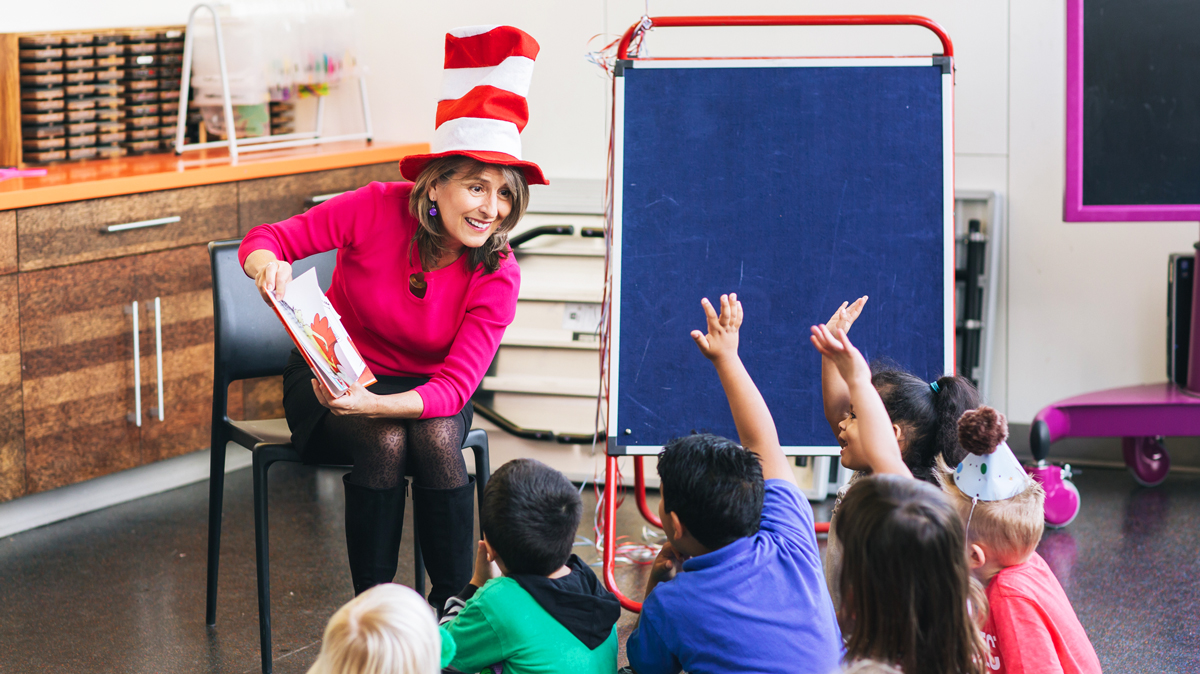Photo of Councilmember Lorie Zapf reading Green Eggs and Ham to children.