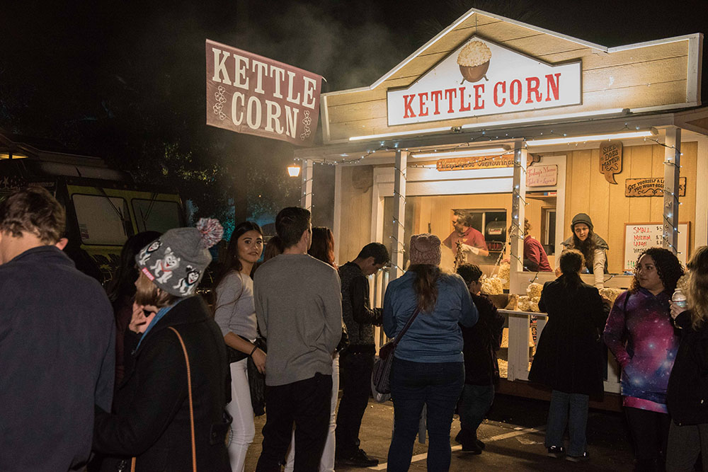 Attendees buying kettle corn at December Nights 2017