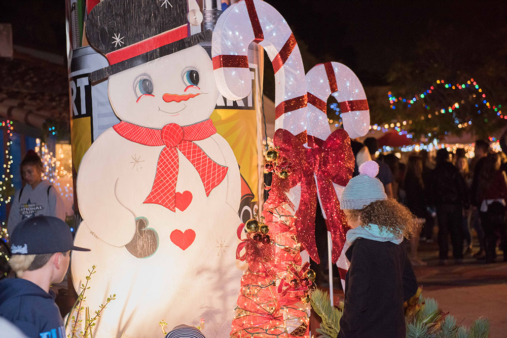 A child looking at a snowman fixture at December Nights 2017