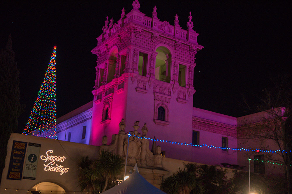 The Prado illuminated with pink light during December Nights 2017