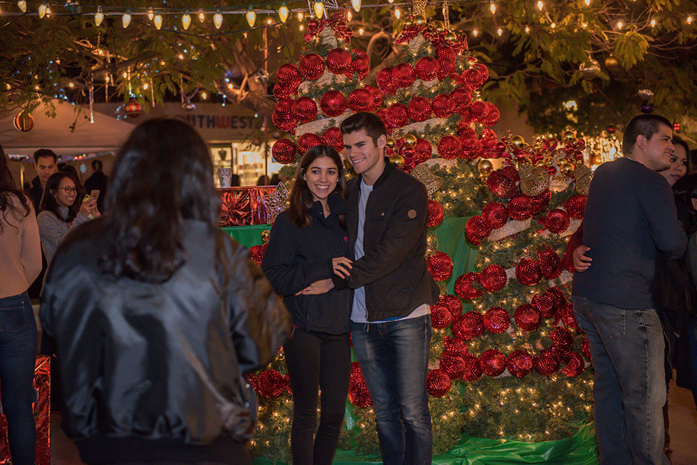 A young couple taking a photo at December Nights 2017