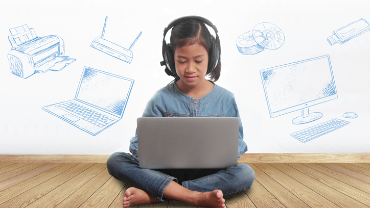 Image of girl sitting in front of laptop