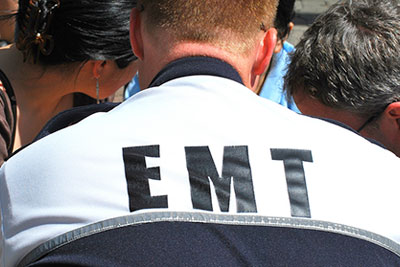 Photo of EMT working on a patient