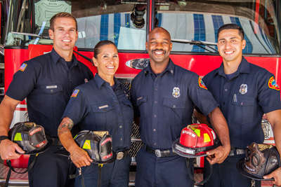 Photo of firefighters in front of a firetruck