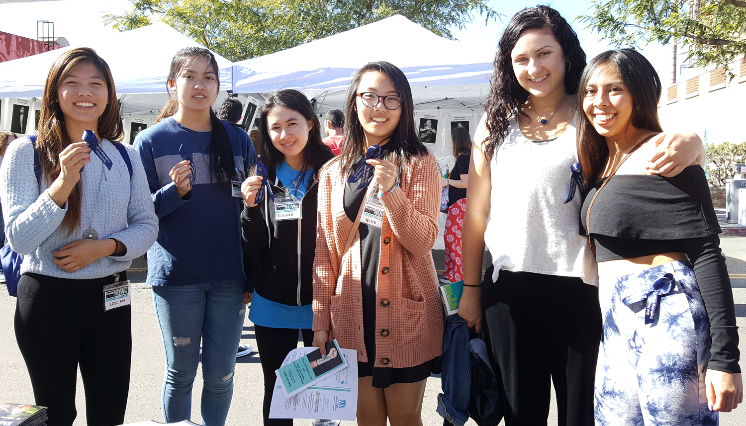 Photo of Freedom Now Fair attendees wearing the City's Blue ribbon in solidarity.