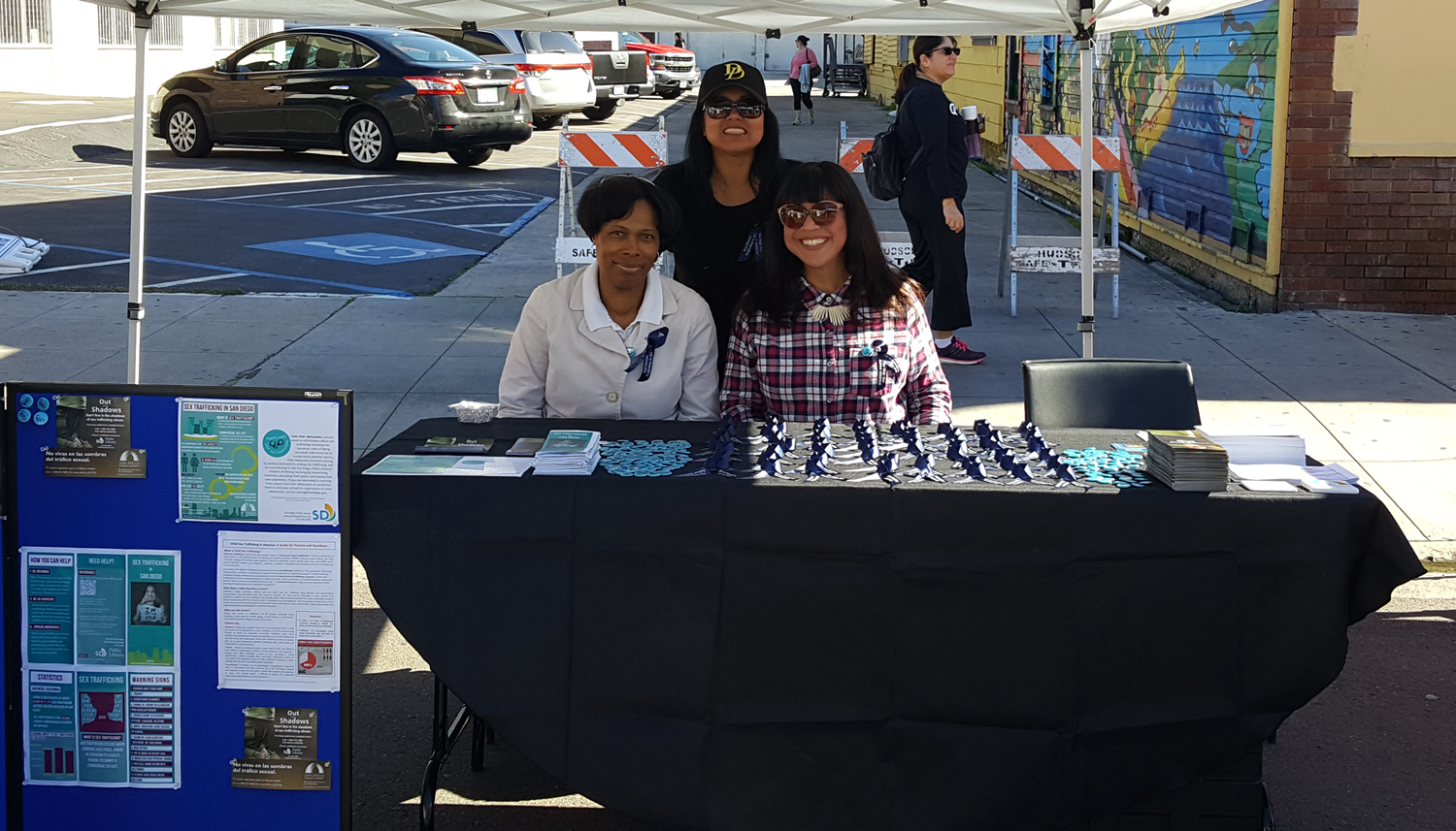 Photo of Library staff working the booth at the Freedom Now Fair.