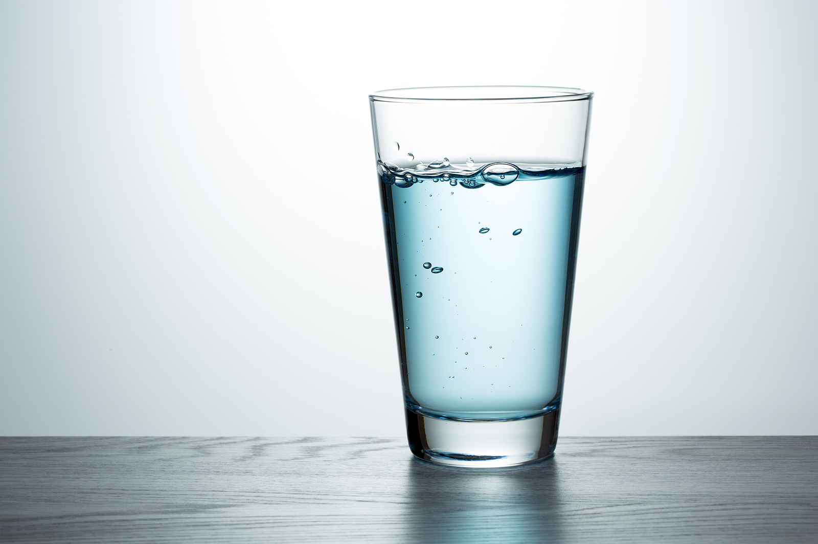 Glass of water on a desk