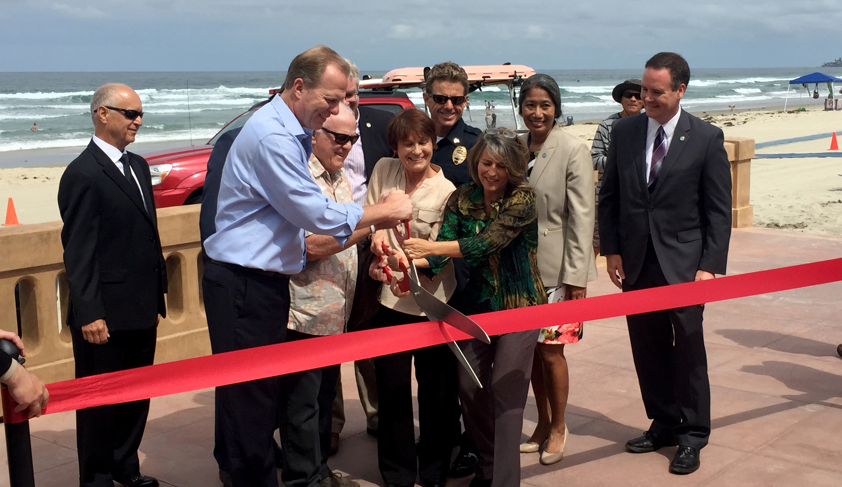 Mayor Kevin Faulconer, Councilmember Lorie Zapf and community leaders cut the ribbon on the reconstructed Mission Beach boardwalk.