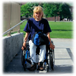 Photo of woman in a wheelchair going down a ramp