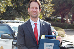 Photo of Councilmember Kersey with an AED