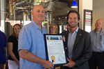 Photo of Councilmember Kersey Presenting the proclamation for Ballast Point Weeks
