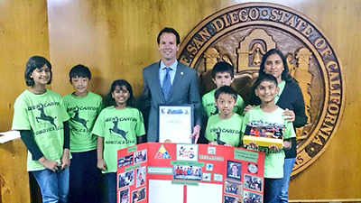 Photo 1 of 1: Councilmember Kersey Presenting the Deer Canyon Robotics team with a proclamation