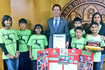 Photo of Councilmember Kersey Presenting the Deer Canyon Robotics team with a proclamation