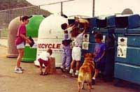 Photo of People Using Recycling Bins
