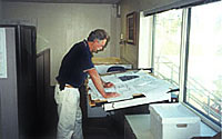 Photo of man looking over blueprints