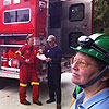 Firefighters Ben Vernon and Mike Rea review their notes
