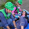 Photo of Volunteers Placing Splint on Patient