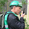 Photo of Team Member Using a Walkie Talkie