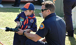 Photo of Firefighter and Boy Scout