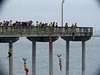 Kids jumping off a pier into the water