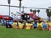 An officer talking to kids about the Fire-Rescue helicopter