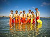 Image of seven kids standing in water