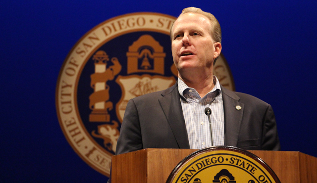Photo of Mayor Faulconer at the Podium with the City Seal in the Background