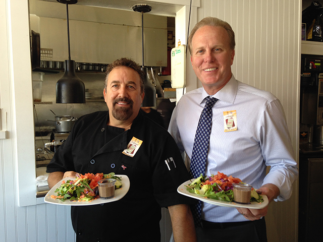 Photo of Mayor Faulconer serving at Dining Out for Life
