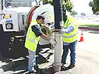 Photo of Two City Workers Cleaning Sewer Mains