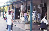 Photo of Volunteers Paintings the Recreation Center