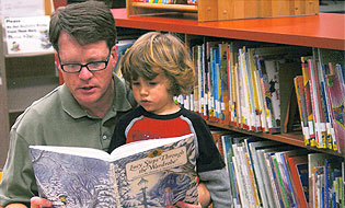 Man reading to child