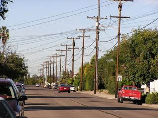 Photo of street with utility poles