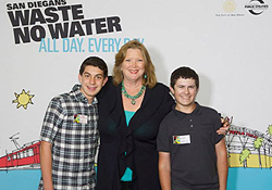Photo of Councilmember Marti Emerald with two student filmmakers