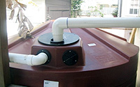 Photo Storage Tank Shown with an Inlet Pipe and Overflow Tube