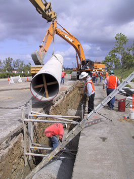 Photo of workers moving pipe