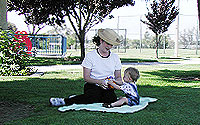 Photo of Child and Adult in Park