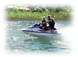 Photo of man and child on jetski