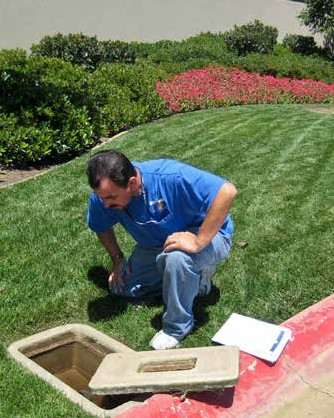 Photo of Man Reading a Water Meter