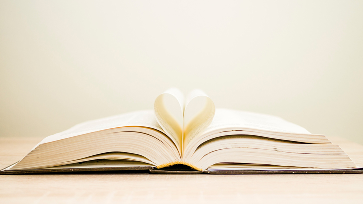 Photo of book with pages creating a heart