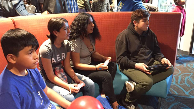 Teens playing video games inside the Legler Benbough Teen IDEA La.