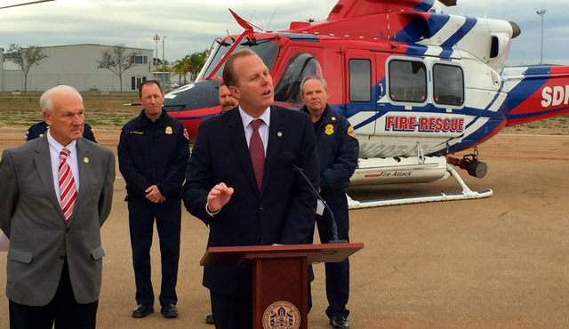 Photo of Mayor Faulconer and County Supervisor Ron Roberts in front of Rescue Helicopter